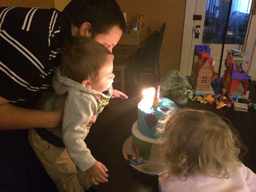 Blowing out birthday cake candles