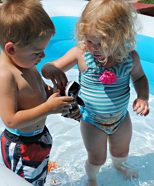 Sharing SwimWays Gobble Gobble Guppies pool toys with each other