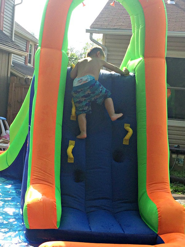 Four year old climbing to slide