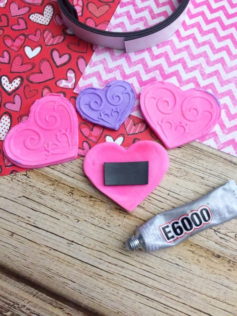Glue magnets to the back of homemade heart shaped magnets