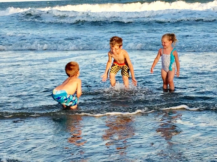kids playing in water at Wrightsville Beach